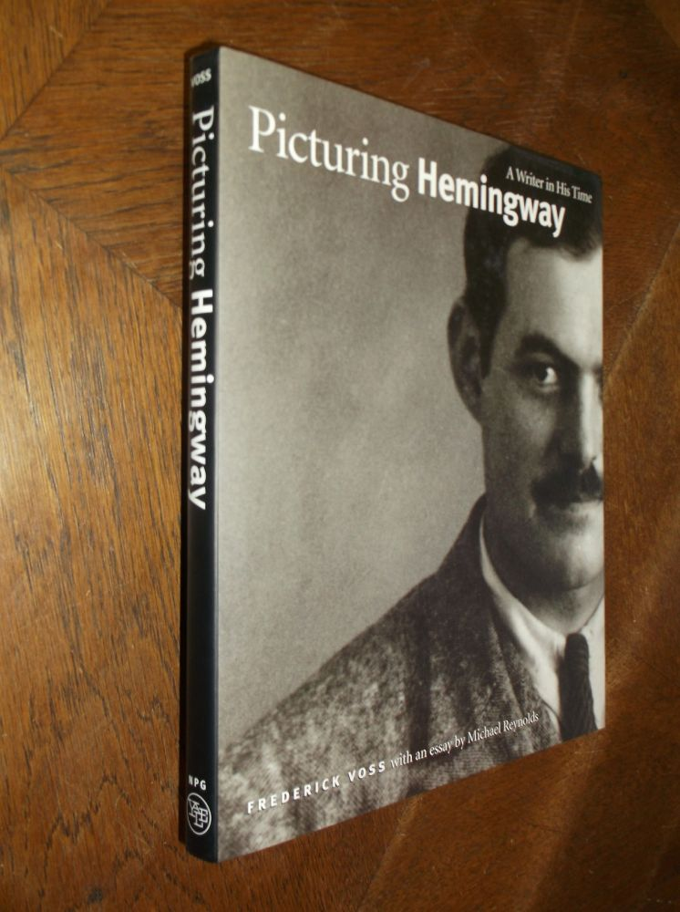 Picturing Hemingway: A Writer in His Time. Frederick Voss, Michael Reynols.